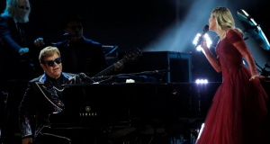 """Elton John and Miley Cyrus perform """"Tiny Dancer"""" during the 60th Annual Grammy Awards Show in New York"""