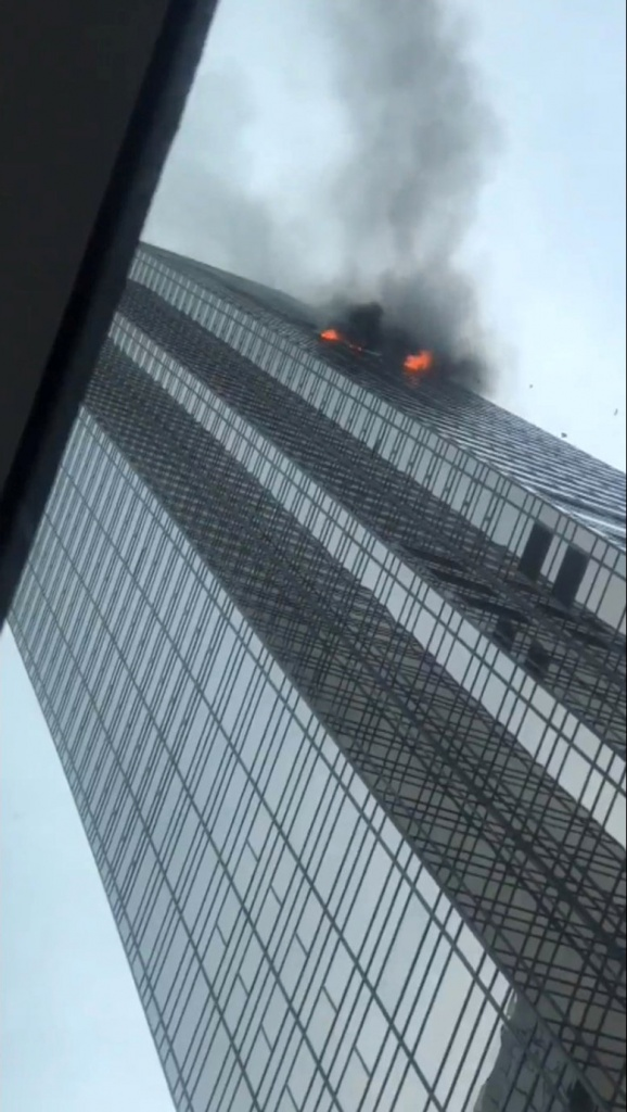 Debris falls during a fire at Trump Tower in New York
