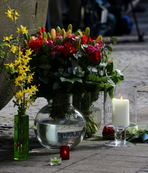 Flowers are seen on the site where on April 7 a man drove a van into a group of people sitting outside a popular restaurant in the old city centre of Muenster