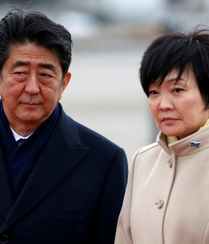 Japan's Prime Minister Shinzo Abe and his wife Akie at Haneda Airport in Tokyo