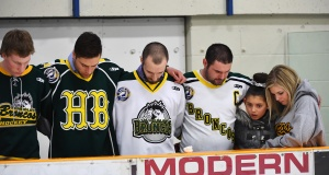 Mourners embrace each other during a moment of prayer at a vigil at the Elgar Petersen Arena, home of the Humboldt Broncos, to honour the victims of a fatal bus accident in Humboldt