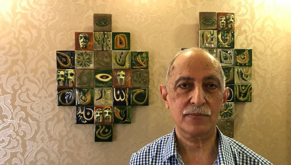 Artist and teacher Salam Atta Sabri poses at his home in Baghdad