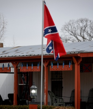 A trailer home displays four confederate battle flags in Franklin County