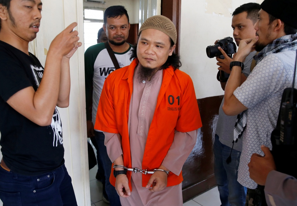 Kiki Muhamad Iqbal, convicted of masterminding suicide bombings at Jakarta's bus terminal in 2017, leaves the courtroom after his trial in Jakarta