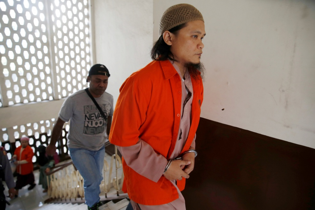 Kiki Muhamad Iqbal, convicted of masterminding suicide bombings at Jakarta's bus terminal in 2017, arrives to the courtroom during his trial in Jakarta