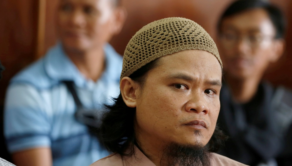 Kiki Muhamad Iqbal, convicted of masterminding suicide bombings at Jakarta's bus terminal in 2017, sits in the courtroom during his trial in Jakarta