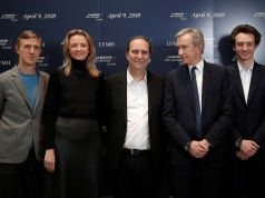 """Ian Rogers, Delphine Arnault, Xavier Niel, Bernard Arnault, Frederic Arnault pose for a photograph at """"Station F"""", a mega-campus for startups located inside a former freight railway depot in Paris"""