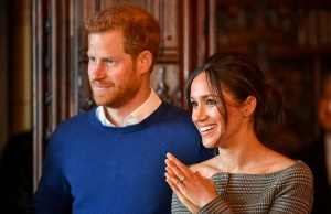 Britain's Prince Harry and his fiancee Meghan Markle watch a performance by a Welsh choir in the banqueting hall during a visit to Cardiff Castle in Cardiff