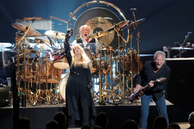 Honorees Stevie Nicks, Mick Fleetwood, and Lindsey Buckingham of the group Fleetwood Mac perform at Radio City Music Hall in Manhattan