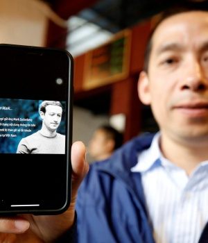 Vietnamese Facebooker and human rights activist, La Viet Dung, shows the open letter signed by himself sent to Facebook Inc.'s chief executive Mark Zuckerberg, in Hanoi