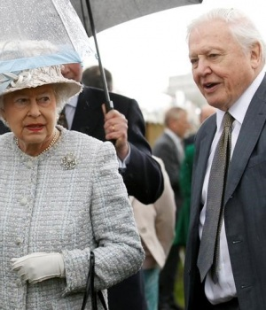 "Britain's Queen Elizabeth walks with broadcaster David Attenborough during her visit to the ""Wild London"" exhibition in Richmond"