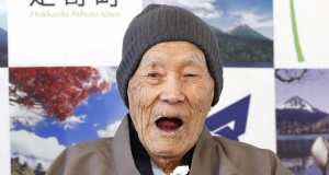 Japanese Masazo Nonaka, who was born 112 years and 259 days ago, eats his favorite cake as he receives a Guinness World Records certificate naming him the world's oldest man during a ceremony in Ashoro
