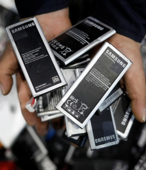 Old smartphone batteries are seen at an urban mining plant in Gunsan