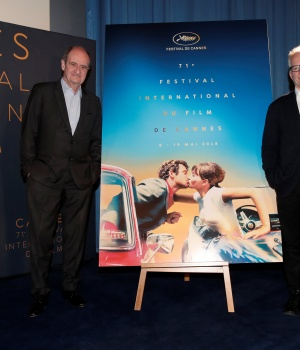 Cannes Film festival general delegate Thierry Fremaux and Cannes Film festival president Pierre Lescure pose in front of the official poster for the 71st Cannes Film Festival after a news conference to announce the official selection, in Paris