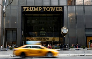 People gather outside the 5th Avenue entrance to Trump Tower in New York
