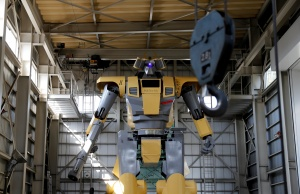 Sakakibara Kikai's engineer Masaaki Nagumo rides a lift to board the bipedal robot Mononofu during its demonstration at its factory in Shinto Village