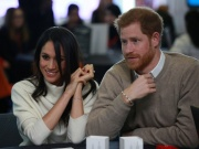 Britain's Prince Harry and his fiancee Meghan Markle attend an event at Millennium Point to celebrate International Women's Day in Birmingham