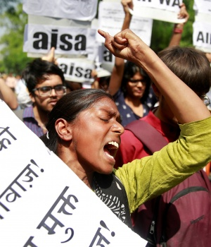 Woman reacts at protest against rape of girl and teenager, in New Delhi