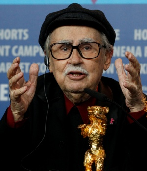 Director Vittorio Taviani gestures behind the Golden Bear award for the best film 'Caesare Deve Morire' ('Caesar Must Die') during a news conference after the awards ceremony of the 62nd Berlinale International Film Festival in Berlin