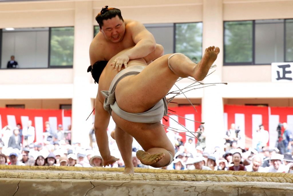 Sumo wrestlers compete during an annual sumo tournament dedicated at the Yasukuni Shrine in Tokyo