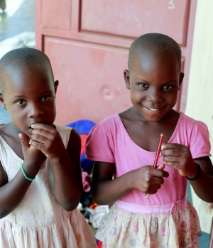 Twin sisters Nakato Rahian and Babirye Sumayia, who were kidnapped and later rescued by Uganda police, pose for a picture at their home in Luwero town