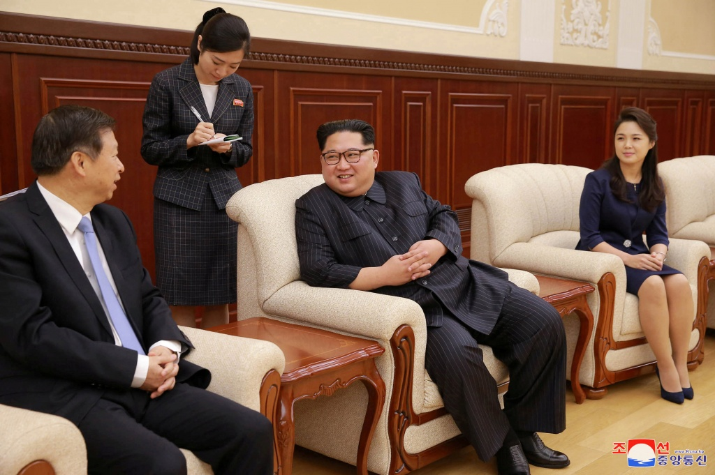 North Korean leader Kim Jong Un and his wife Ri Sol Ju meet with the head of the China's Communist Party's International Department Song Tao