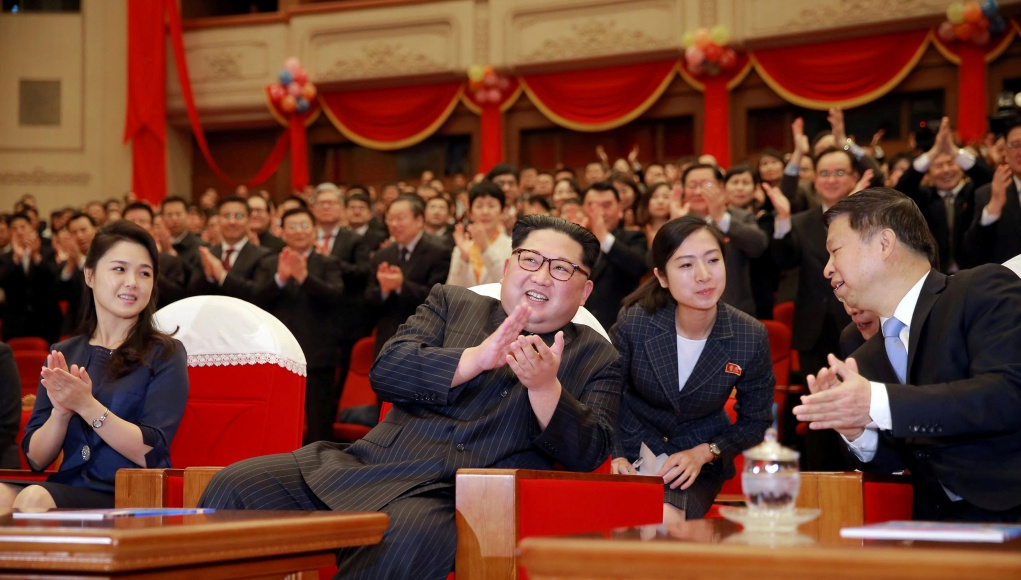 North Korean leader Kim Jong Un and his wife Ri Sol Ju applaud with the head of the China's Communist Party's International Department Song Tao