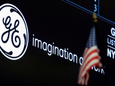 The ticker and logo for General Electric Co. is displayed on a screen at the post where it's traded on the floor of the NYSE