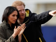 Britain's Prince Harry, Patron of the Invictus Games Foundation, and Meghan Markle watch athletes at the team trials for the Invictus Games Sydney 2018 at the University of Bath Sports Training Village in Bath