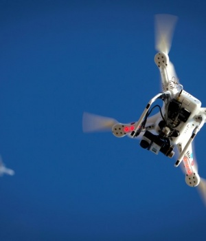An airplane flies over a drone on Coney Island in the Brooklyn borough of New York