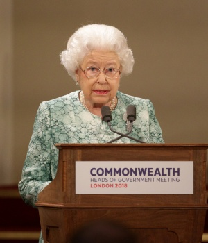 Britain's Queen Elizabeth speaks at the formal opening of the Commonwealth Heads of Government Meeting in the ballroom at Buckingham Palace in London