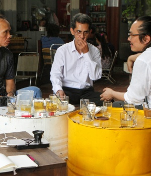 Vietnamese deportees and Amerasians Bui Thanh Hung and Pham Chi Cuong speaks to U.S. lawyer and Vietnamese-American Tin Nguyen at a cafe in the suburbs of Ho Chi Minh City