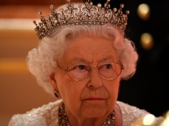 Britain's Queen Elizabeth listens during speeches at The Queen's Dinner during the Commonwealth Heads of Government Meeting at Buckingham Palace in London, Britain