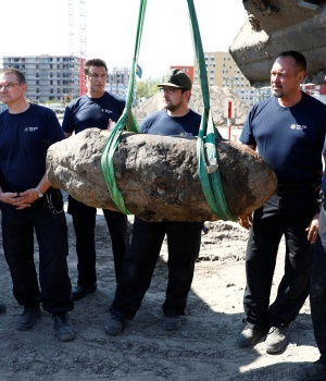 The bomb defusing team pose with dismantled World War Two bomb at a construction site next to the central train station in Berlin
