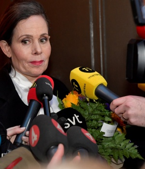 The Swedish Academy's Permanent Secretary Sara Danius talks to the media as she leaves after a meeting at the Swedish Academy in Stockholm