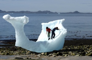 Children play amid icebergs on the beach in Nuuk