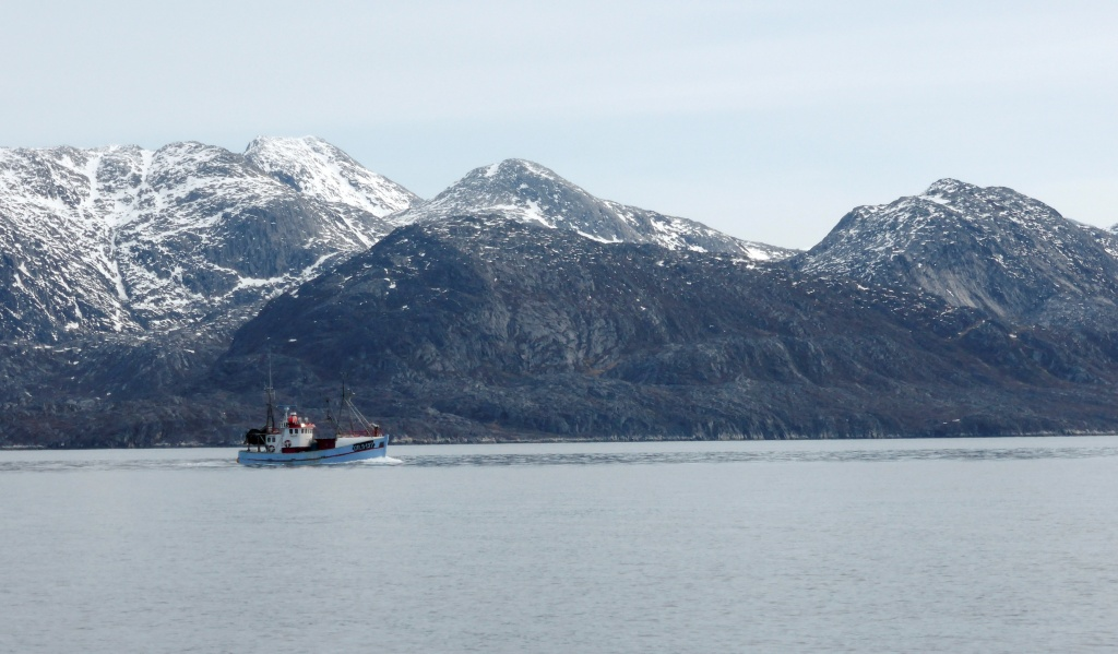 A fishing boat sets out from near the port of Nuuk