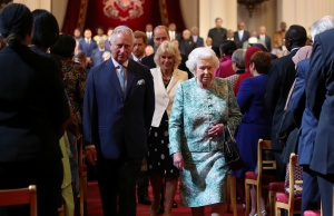 Britain's Queen Elizabeth and Prince Charles leave after the formal opening of the Commonwealth Heads of Government Meeting in the ballroom at Buckingham Palace in London
