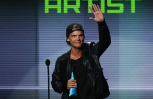 Avicii accepts the favorite electronic dance music artist award at the 41st American Music Awards in Los Angeles