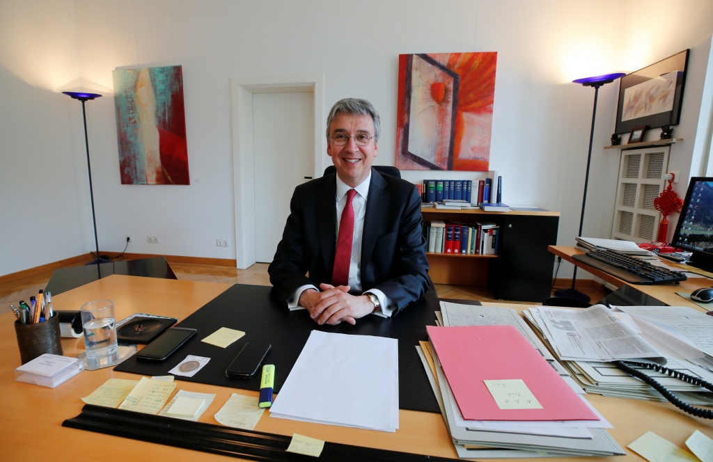 Andreas Mundt, president of Germany's Federal Cartel Office, is pictured at his desk before an interview with Reuters in Bonn