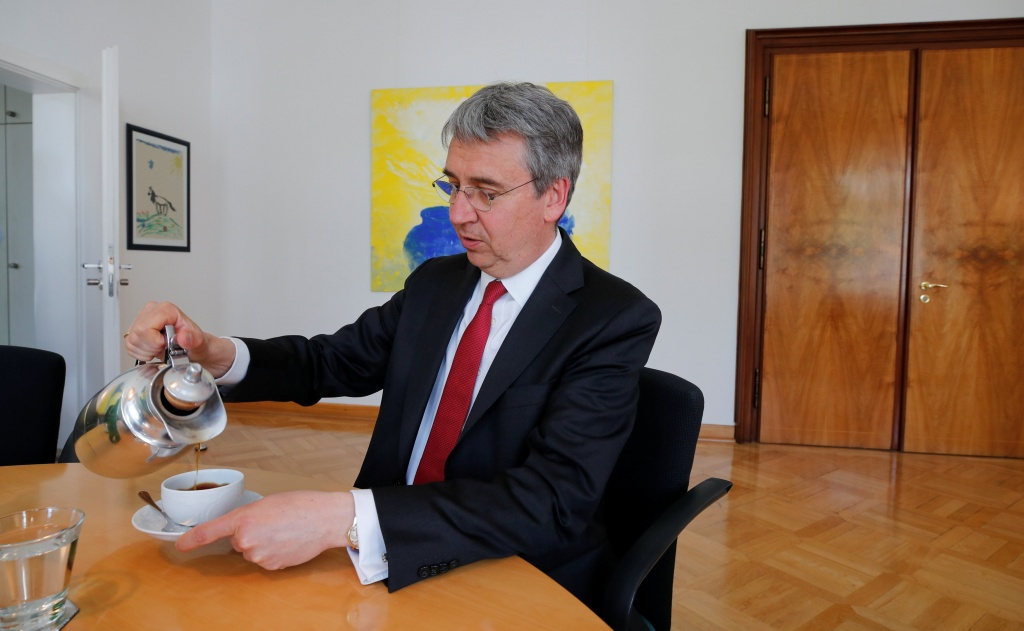 Andreas Mundt, president of Germany's Federal Cartel Office, fills his cup with coffee during an interview with Reuters in Bonn