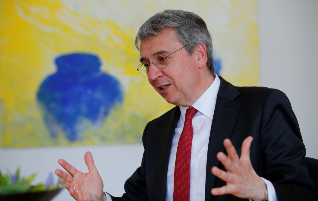 Andreas Mundt, president of Germany's Federal Cartel Office, gestures during an interview with Reuters in Bonn