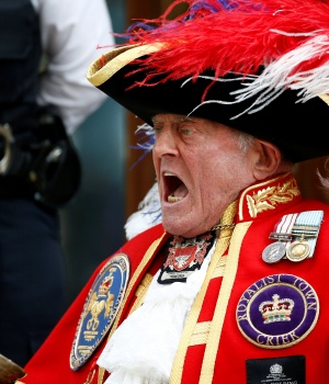 A man dressed as a town crier shouts outside the Lindo Wing of St Mary's Hospital after Britain's Catherine, the Duchess of Cambridge, gave birth to a son, in London