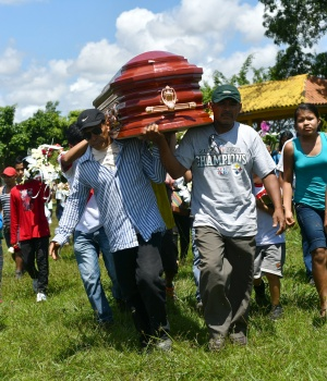 People attend the burial of Olivia Arevalo in Pucallpa