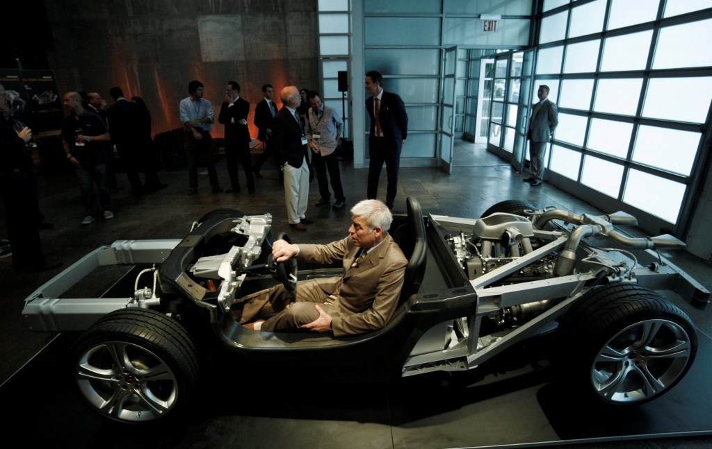 McLaren Automotive design director Frank Stephenson Santos sits inside the chassis of the MP4-12C high-performance sports car in New York