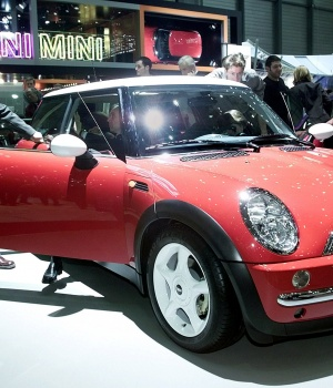A visitor looks at the new Mini Cooper on display as a first world presentation at the Geneva car show