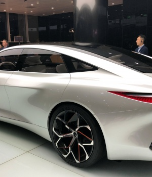 People gather around Infiniti's Q Inspiration concept car at an event in Beijing