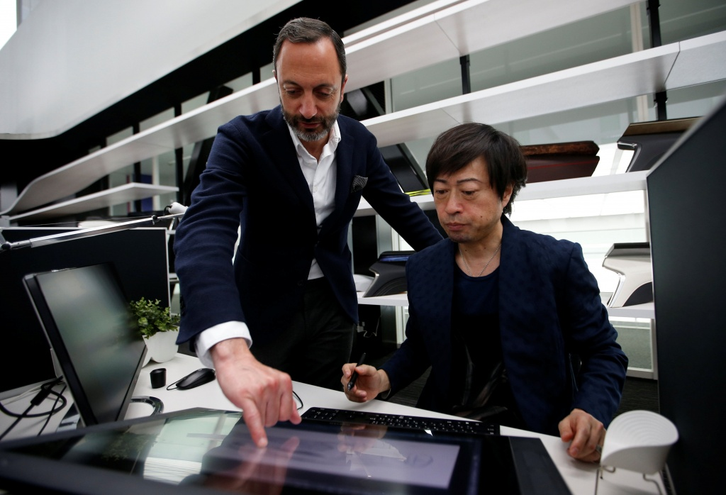 Infiniti, Nissan Motor's premium brand, Executive Design Director Habib looks at a monitior with Creative Design Manager Komuro at its Global Design Center in Atsugi,