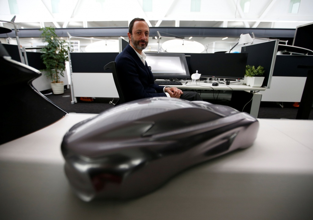 Infiniti, Nissan Motor's premium brand, Executive Design Director Habib poses for a photo behind the brand's car model at its Global Design Center in Atsugi