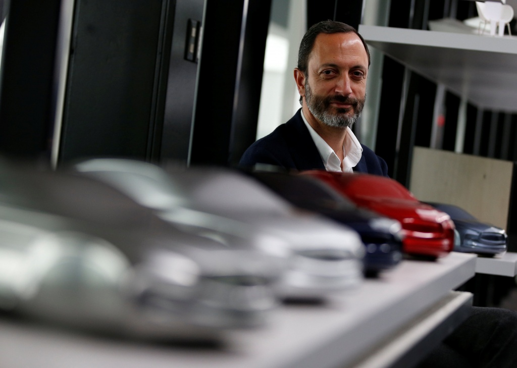 Infiniti, Nissan Motor's premium brand, Executive Design Director Habib poses for a photo behind the brand's car models at its Global Design Center in Atsugi